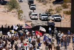Protesters gather at the Bureau of Land Management's base camp near Bunkerville, Nevada